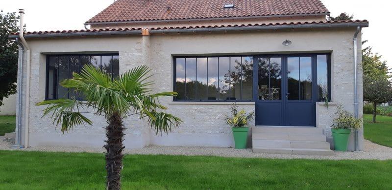 extension de maison en pierre avec verriere