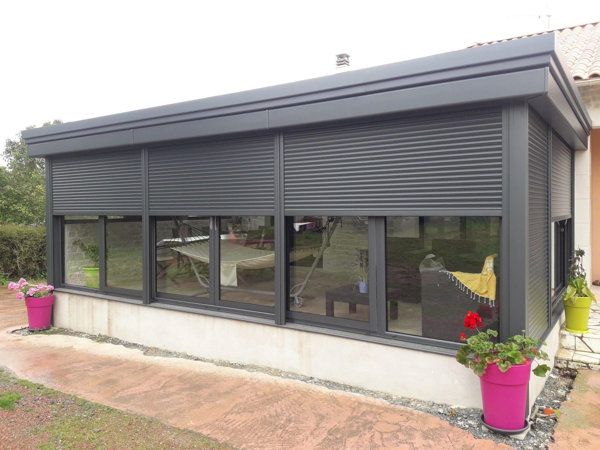 Extension de maison avec une véranda à Aiffres - Agrandissement
