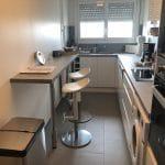 rénovation appartement cuisine aménagée tiroirs hotte plaque de cuisson électroménager carrelage Paris 11e arrondissement