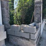 rénovation poteau mouluré mur pendant travaux parpaing Villeurbanne