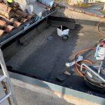 Pose de l'étanchéité première couche - rénovation d'un toit terrasse à Cognac
