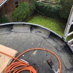 Pose de l'étanchéité première couche - - rénovation d'un toit terrasse à Cognac