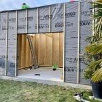 Montage des murs et pose de l'isolation - Construction d'une extension maison en bois à Arques