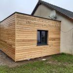 Création d'une extension bois à toit plat à Forêt la Folie dans l'Eure